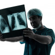Doctor surgeon radiologist examining lung torso x-ray image — Stock Photo #32582747