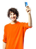 Young man happy holding credit card portrait — Stock Photo