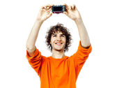 Young man holding camera photographing portrait — Stock Photo
