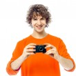 Young man photographer holding camera portrait — Stock Photo #32981645