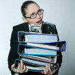 Business woman carrying files and folders — Stock Photo