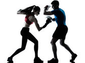 Coach man woman exercising boxe — Stockfoto