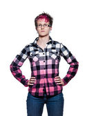 Serious woman standing with arms on waist — Stock Photo