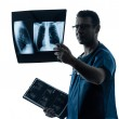 Doctor surgeon radiologist examining lung torso x-ray image — Stock Photo #33977565
