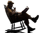 Sherlock holmes reading silhouette — Stock Photo