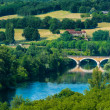 Stock Photo: Medieval bridge over dordogne river