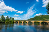 Medieval bridge over the dordogne river — Stock Photo