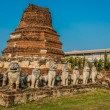 Stock Photo: Chedi surrounded lion statues