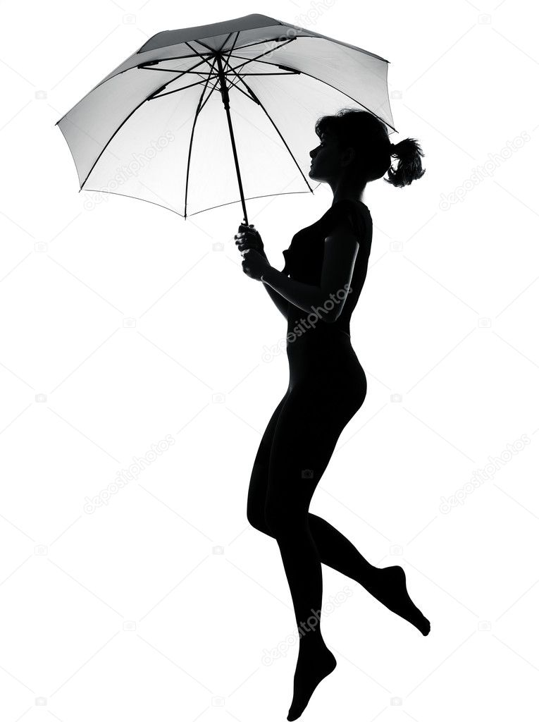 Silhouette woman flying holding open umbrella — Stock ...