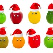 Set of fruit with eyes in red hats of Santa Claus — Stock Photo
