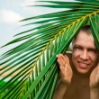 The man of palm trees — Stock Photo