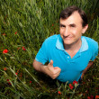 Green thumbs up poppy man - Foto Stock