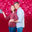 Stock Photo: Valentine buyers pregnant
