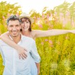 Outstretched carefree couple — Stock Photo #39355135
