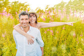 Outstretched carefree couple — Foto Stock