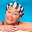 Mature in pool — Stock Photo #44151017