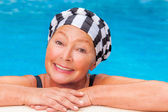 Mature in pool — Stock Photo