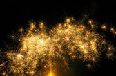 Golden fireworks at dark sky — Stock Photo