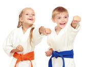 Funny athletes in kimono beat hand — Stock Photo