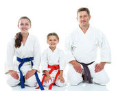 Dad with two daughters sitting in a ritual pose Karate — Stock Photo