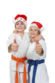 Two athletes in the cap Santa Claus show finger super — Stock Photo