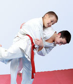 Two boys with white and red belt perform throw judo — Stock Photo