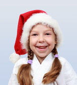 The little girl of four years with a cap on his head santa claus — Stock Photo