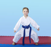 Girl athlete stands in rack of karate — Stock Photo