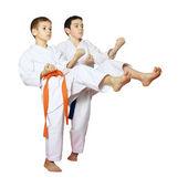 On a white background boys athletes train beat kicks — ストック写真