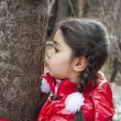 Stock Photo: Girl kissing tree.