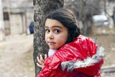 Girl in red jacket and a tree. — 图库照片