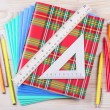 Stock Photo: Notebooks,ruler,triangle, pen and pensil on table