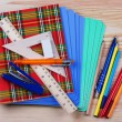 Notebooks,ruler,triangle, pen and pensil on the table — Stock Photo