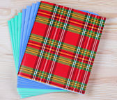 Bright notebooks om the table — Stock Photo