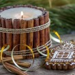 Foto Stock: Christmas cookies with candle made from vanillsticks