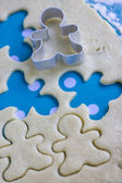Christmas baking background: dough and cookie cutters. Viewed fr — Stockfoto