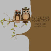Pair of owls on branch — Stockvector
