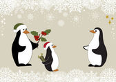 Christmas penguins — Stock Vector