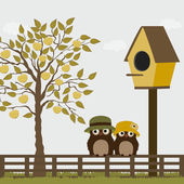 Cute owls on a fence with birdhouse and apple tree — Stock Vector