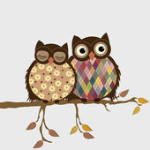 Pair of owls on branch in autumn — Stock Vector