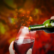 Red Celebration Wine with Sparkles - Stock Photo