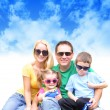 Stock Photo: Happy Family in Summer with Clouds