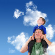 Father and Son Looking up in Cloud Sky — Stock Photo #15551845