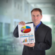 Business Man Holding Graph Chart — Stock Photo