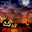 Scary Halloween Pumpkins at Night — Stock Photo #15552579