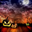 Scary Halloween Pumpkins at Night — Stok fotoğraf #15552579