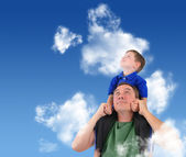 Father and Son Looking up in Cloud Sky — Stock Photo