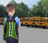 School Boy Looking at Bus with Bookbag — Stock Photo