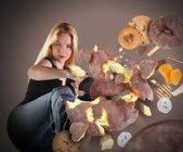 Diet Woman Kicking Junk Food — Stock Photo