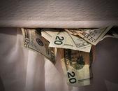 Hiding Money in Mattress — Stock Photo